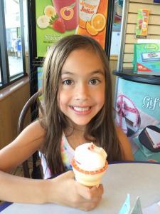 Happy with her ice cream cone.