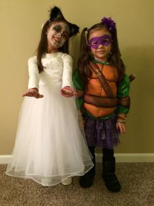 Kaiya is a zombie bride cat (why be one when you can be them all?) and Mylee is a ninja turtle (with a tutu).