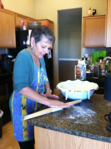 I'm preparing the pizza dough in the bowl.