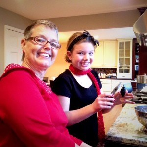 Addie and Nana clean mussels in preparation for Christmas Eve dinner.