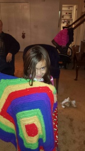 Kaiya loves her new afghan made by Nana!