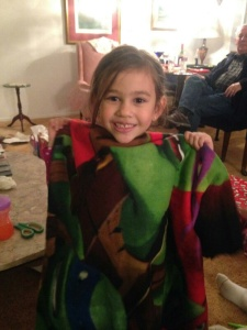 Mylee happily displays her Ninja Turtle blanket.