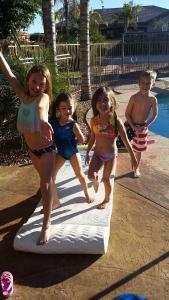 Despite the fact that the unheated swimming pool was icy, Kaiya and Mylee took a dip with their cousins Kenzie and Carter.