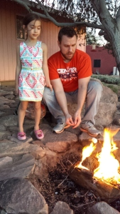 Court shows Kaiya how to correctly roast a marshmallow to achieve perfect golden brownness.