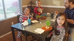 Austin joins his cousins for donuts.