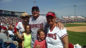 The whole Borman clan enjoy the ball game.