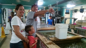 Carter and Josey are quality control while Erik picks out the crabs.