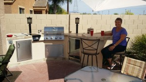 Here I am enjoying an adult beverage at the bar of our spectacular outdoor kitchen!