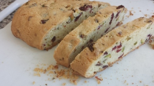 You first bake the loaf of biscotti.....