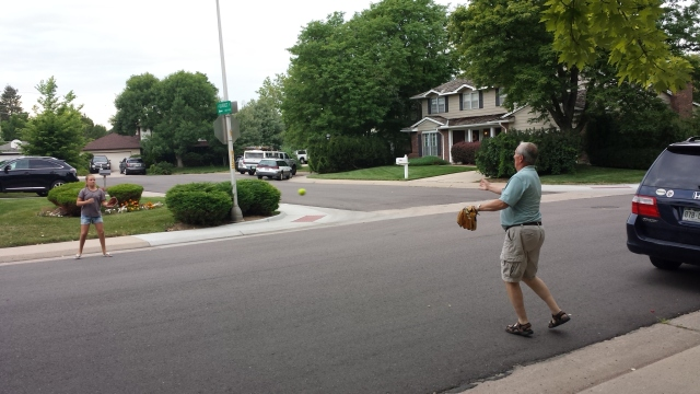 Addie and Papa play catch in the street. No broken windows. Or bones.