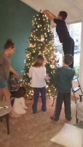 Grandkids decorating the angel tree.