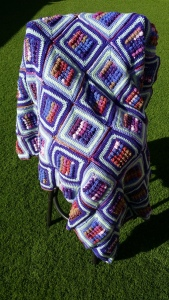purple afghan draped