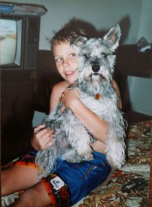 Court poses with our Miniature Schnauzer (who wouldn't win a dog show) Fritz.
