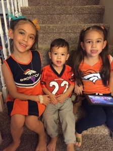 Kaiya, Cole, and Mylee show their Bronco colors.