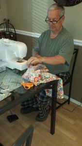 Bill sewing Bec apron