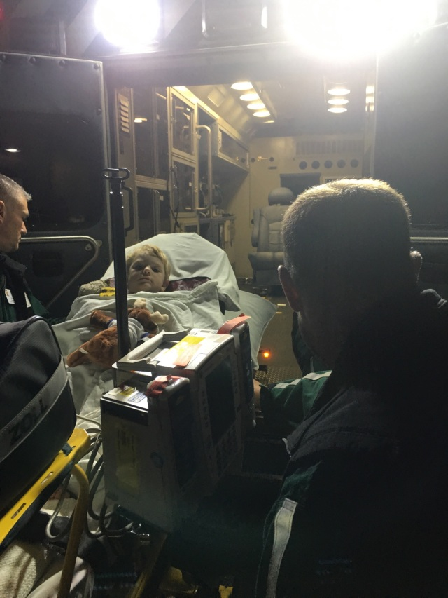 Micah in the ambulance to Burlington, VT.