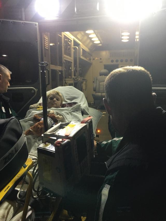 Micah in the ambulance to Burlington, VT.