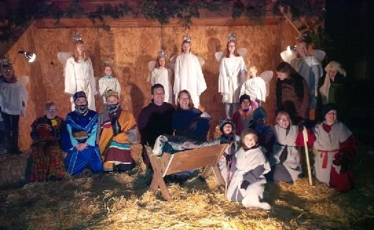 The children from Wellshire Presbyterian Church performed a living nativity Sunday night in the frigid weather. The little shepherd kneeling in front is Maggie Faith. The shepherd behind her wearing glasses is Dagny. Addie is the wise man wearing the gold robe. Dagny and Maggie chose to be shepherds because, well, live goats were involved.