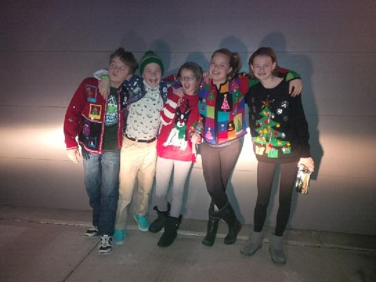 Left to right -- Spencer, wearing the prize-winning sweater; Alastair Luci, Addie, and Mettie. Apparently, when it comes to Ugly Sweater Contests, all sweaters are gender-neutral.